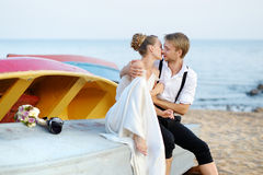 Happy bride and groom hugging by the sea Royalty Free Stock Photo