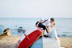 Happy bride and groom hugging by the sea Royalty Free Stock Image