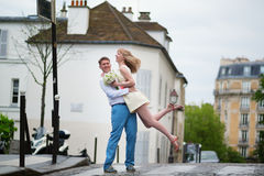 Happy bride and groom hugging on a street of Paris Royalty Free Stock Images