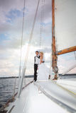 Happy bride and groom hugging on a yacht Stock Photo