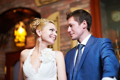Happy bride and groom indoors Royalty Free Stock Image