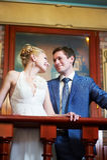 Happy bride and groom in interior stock image