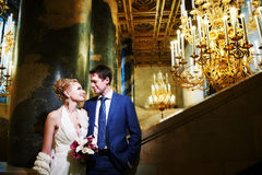 Happy bride and groom in interior of hotel Stock Photos