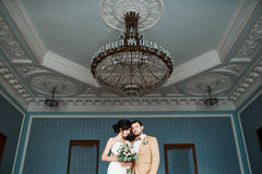 Happy bride and groom in interior of hotel. wedding day Royalty Free Stock Photos