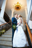 Happy bride and groom kissing Royalty Free Stock Images