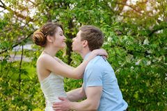 Happy bride and groom kissing on wedding in park Royalty Free Stock Images