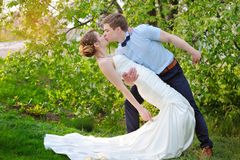 Happy bride and groom kissing on wedding in park Royalty Free Stock Photos