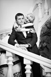 Happy bride and groom on a ladder Stock Image