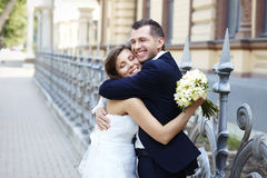 Happy bride and groom laughing smiling hugging on wedding day.  stock photography