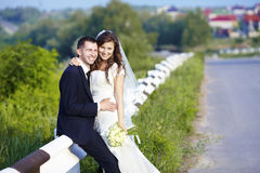 Happy bride and groom laughing smiling on the road on a wedding. Royalty Free Stock Photo