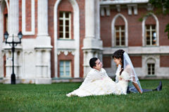 Happy bride and groom on lawn royalty free stock photo