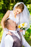 Happy bride and groom looking into the eyes Stock Photo