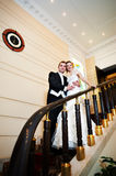 Happy bride and groom at luxurious stairs Royalty Free Stock Image