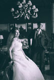 Happy bride and groom in luxury chairs in chic interiors Royalty Free Stock Photography