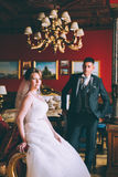 Happy bride and groom in luxury chairs in chic interiors Royalty Free Stock Images