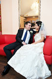 Happy bride and groom in luxury palace Royalty Free Stock Image