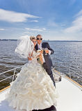 Happy bride and groom on a luxury yacht. Royalty Free Stock Photos