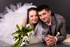 Happy bride and groom lying Royalty Free Stock Photo