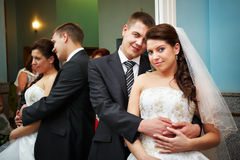Happy bride and groom in marriage palace stock photo