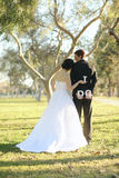 Happy Bride and Groom Married Outdoors in a Forest Royalty Free Stock Image