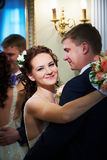 Happy bride and groom about mirror Stock Photography