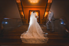 Happy bride and groom in the modern hotel hall Stock Photography