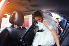 Happy bride and groom near car. Royalty Free Stock Photos