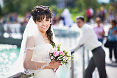 Happy bride and groom near fountain Royalty Free Stock Images