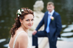 Happy bride and groom near lake Stock Photography
