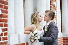 Happy bride and groom near palace Royalty Free Stock Image