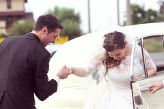 Happy bride and groom near retro car Royalty Free Stock Images