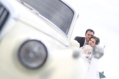 Happy bride and groom near retro car Stock Photo
