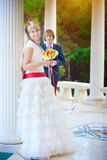 Happy bride and groom near white column. Beautiful happy bride and groom near white column Stock Images