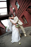 Happy bride and groom about old building Stock Image