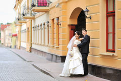 Happy bride and groom in an old town Stock Photos