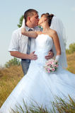 Happy bride and groom outdoors Stock Image