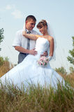Happy bride and groom outdoors Stock Photography