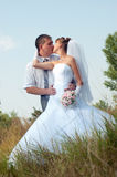 Happy bride and groom outdoors Stock Photo