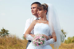 Happy bride and groom outdoors Royalty Free Stock Image