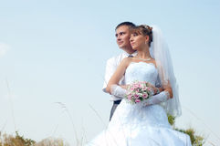 Happy bride and groom outdoors Royalty Free Stock Photography