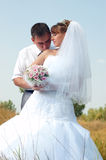 Happy bride and groom outdoors Royalty Free Stock Photo