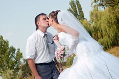 Happy bride and groom outdoors Royalty Free Stock Images