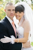 Happy bride and groom outdoors Royalty Free Stock Photos