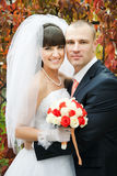 Happy bride and groom outdoors Stock Photos