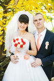 Happy bride with groom outdoors Stock Images