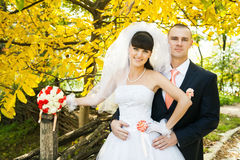 Happy bride with groom outdoors Royalty Free Stock Image