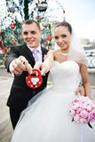 Happy bride and groom with a padlock Stock Photos
