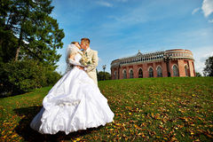 Happy bride and groom in park Stock Photo
