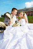 Happy bride and groom in park Royalty Free Stock Image