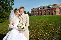 Happy bride and groom in park Royalty Free Stock Images
